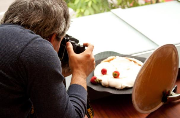 man photographs pavlova
