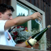 Man Opens Champagne Bottle Using Wine Glass